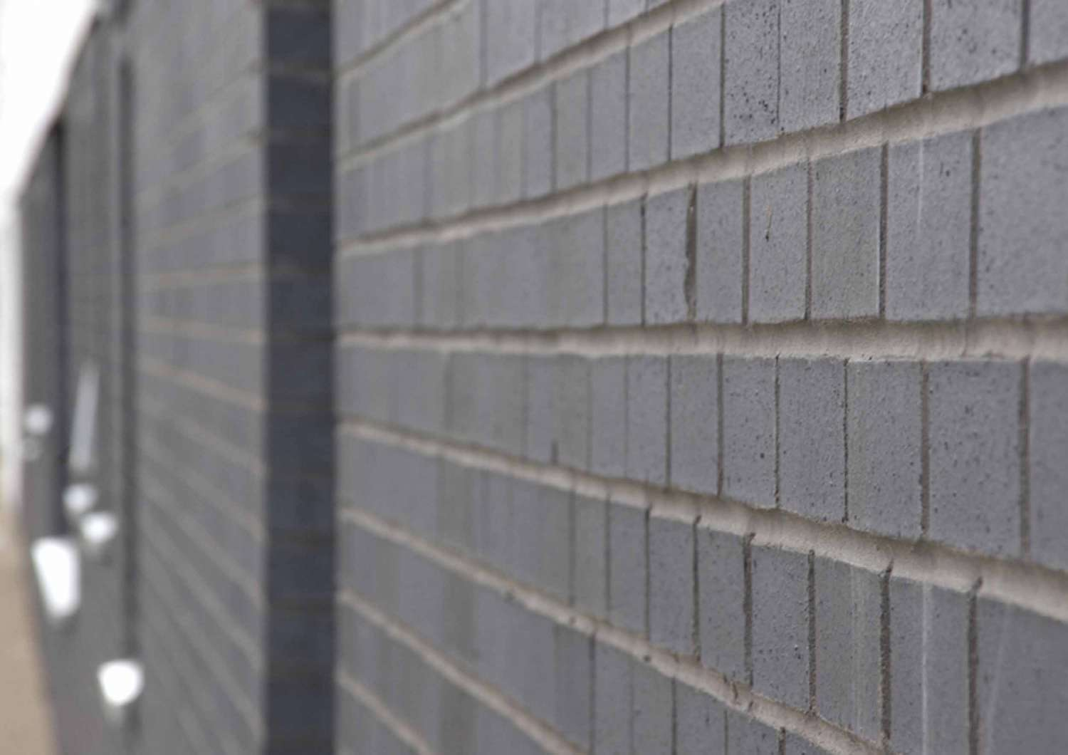 Engineering bricks grey wall