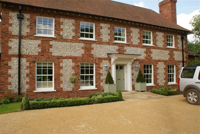 Flint block wall on country house