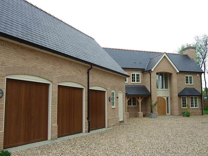 Country bespoke home brick arches