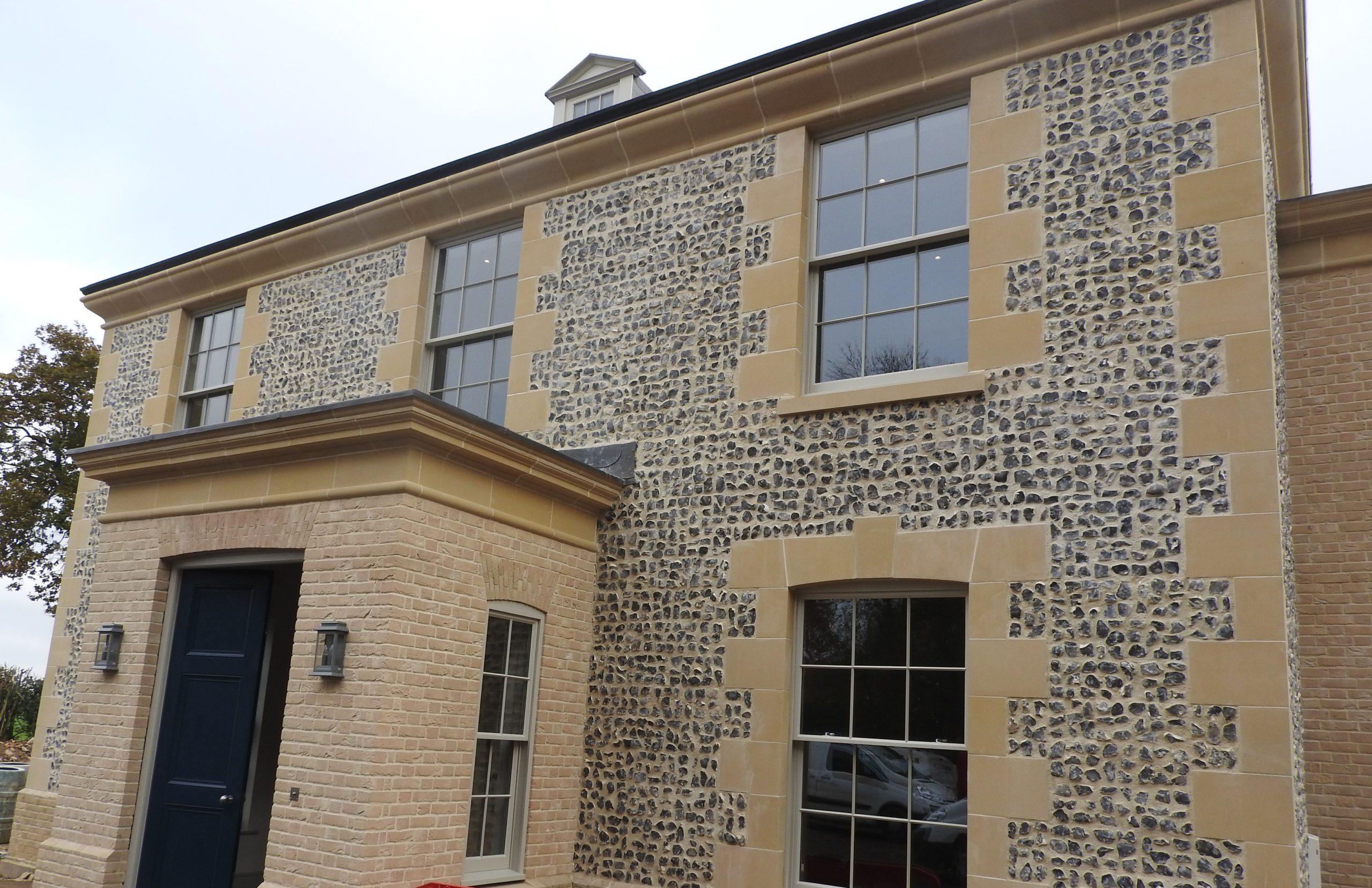 Flint block wall on house