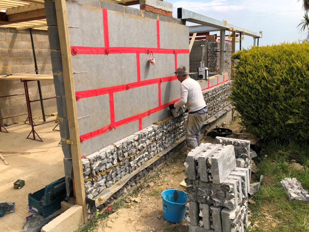 Flint Blocks Being Laid