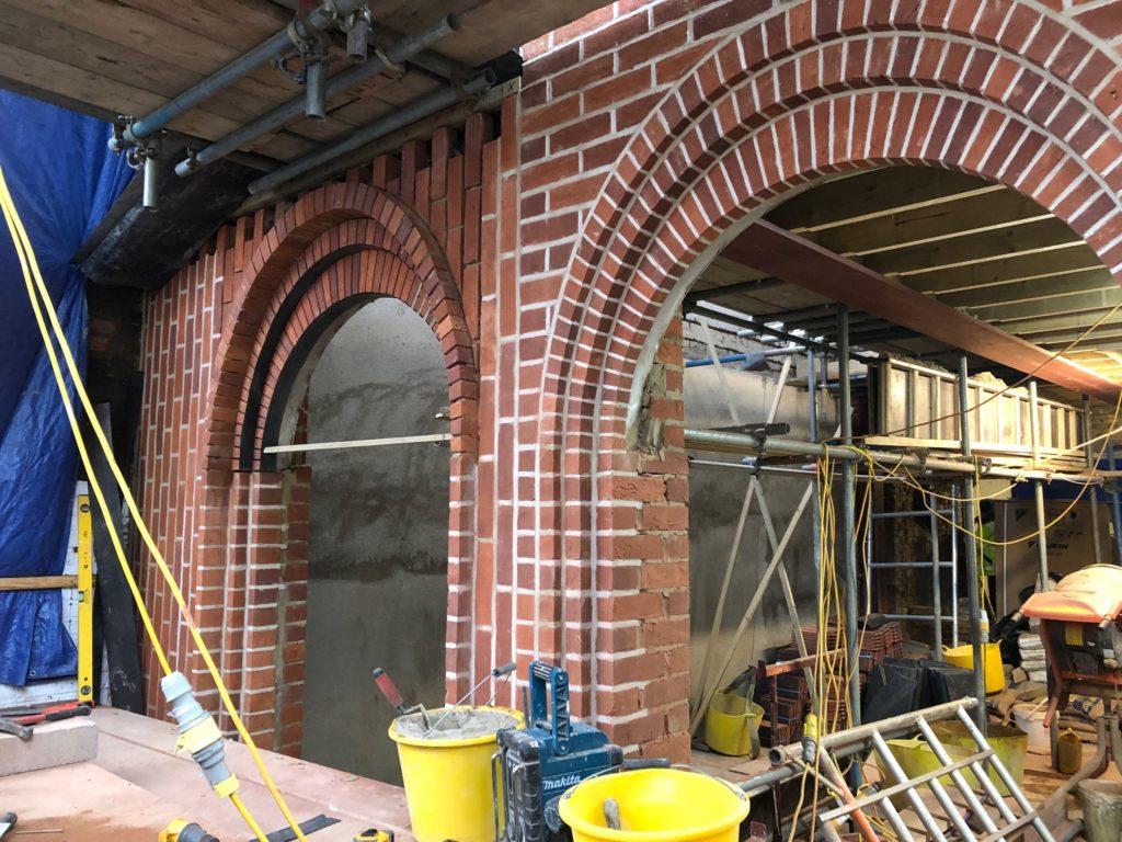 Elliptical Intersecting Brick Arches Installation