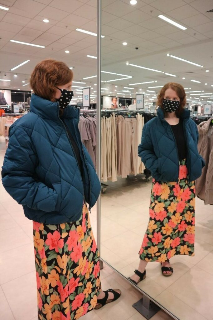 Ellis Tuesday trying on a blue puffer jacket at Primark Braehead Glasgow